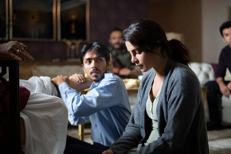 THE WHITE TIGER - Adarsh Gourav (Balram), Priyanka Chopra Jonas (Pinky), Rajkummar Rao  (Ashok) in THE WHITE TIGER. Cr. SINGH TEJINDER / Netflix © 2020