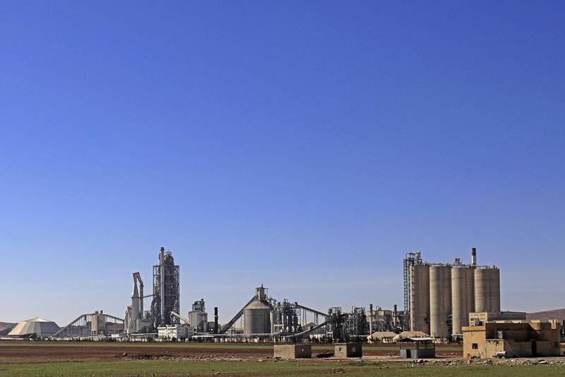 (FILES) This file photo taken on February 19, 2018 shows a general view shows the Lafarge Cement Syria (LCS) cement plant in Jalabiya, some 30 kms from Ain Issa, in northern Syria. French cement maker Lafarge is accused of having financed jihadist groups to maintain its activity in Syria and was placed under an investigation which could lead to indictment sources close to the case revealed on June 28, 2018.  / AFP / Delil souleiman