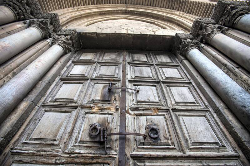 The gigantic closed wooden doors of the  Church of the Holy Sepulchre in the Old City of Jerusalem on Monday February 26,2018.The Church of the Holy Sepulchre  remained closed for a second day after church leaders in Jerusalem closed it to protest against Israeli's announced plans by the cityÕs municipality earlier this month to collect property tax (arnona) from church-owned properties on which there are no houses of worship. Nadal said he was in mourning for the state of Christians in the Holy Land and said he never in his life saw the church closed before . (Photo by Heidi Levine for The National).