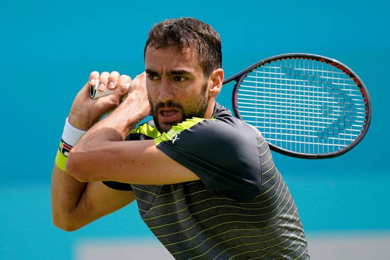 epa07654158 Croatia's Marin Cilic in action during his round of 32 match against Chile's Cristian Garin at the Fever Tree Championship at Queen's Club in London, Britain, 17 June 2019. The tournament runs from 17th June till 23 June 2019.  EPA/WILL OLIVER
