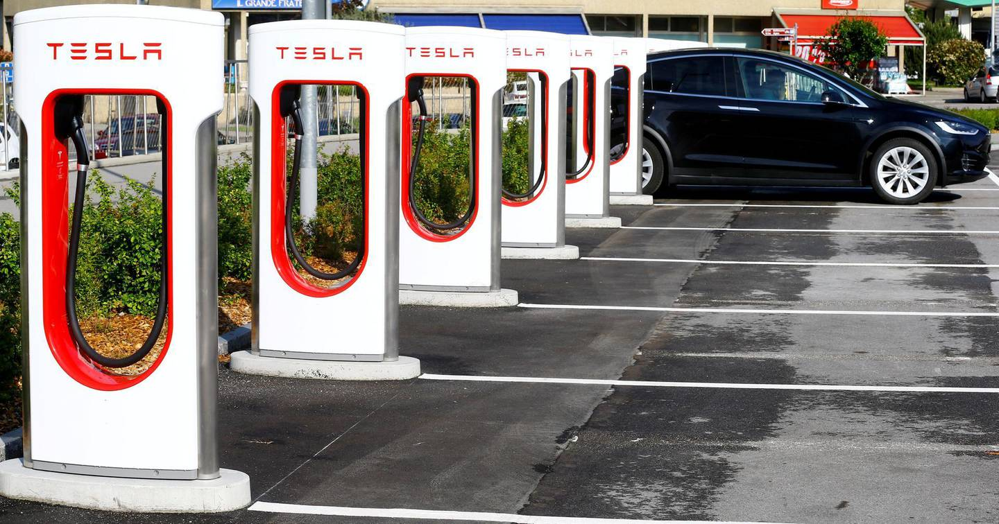 FILE PHOTO: An electric-powered Tesla car stands at a charging station in Melide near Lugano, Switzerland May 9, 2018.     REUTERS/Arnd Wiegmann/File Photo