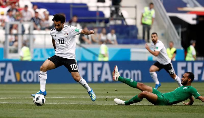 Soccer Football - World Cup - Group A - Saudi Arabia vs Egypt - Volgograd Arena, Volgograd, Russia - June 25, 2018   Egypt's Mohamed Salah in action with Saudi Arabia's Abdullah Otayf      REUTERS/Damir Sagolj