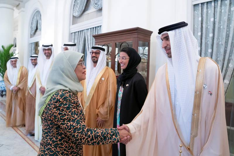 SINGAPORE, SINGAPORE - February 28, 2019: HE Halimah Yacob, President of Singapore (L), greets HE Dr Thani Al Zeyoudi, UAE Minister for Climate Change and Environment (R), prior to a meeting, at the Istana presidential palace.  ( Mohamed Al Hammadi / Ministry of Presidential Affairs ) —