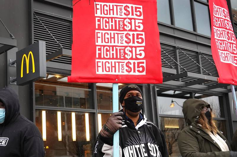 CHICAGO, ILLINOIS - JANUARY 15: Demonstrators participate in a protest outside of McDonald's corporate headquarters on January 15, 2021 in Chicago, Illinois. The protest was part of a nationwide effort calling for minimum wage to be raised to $15-per-hour.   Scott Olson/Getty Images/AFP == FOR NEWSPAPERS, INTERNET, TELCOS & TELEVISION USE ONLY ==