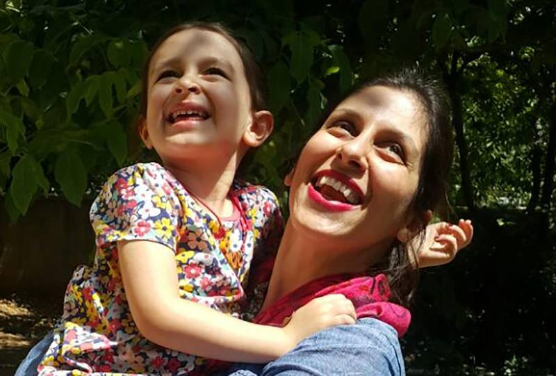 """(FILES) In this file handout photo taken on August 23, 2018 and released by the Free Nazanin campaign on August 23, 2018, Nazanin Zaghari-Ratcliffe (R) embraces her daughter Gabriella in Damavand, Iran following her release from prison for three days. - Nazanin Zaghari-Ratcliffe, the British-Iranian woman who has been held in Tehran for more than two years on sedition charges, returned to prison on August 26, 2018, after temporary release, dashing her family's hopes of an extension. (Photo by - / Free Nazanin campaign / AFP) / RESTRICTED TO EDITORIAL USE - MANDATORY CREDIT """"AFP PHOTO / FREE NAZANIN CAMPAIGN"""" - NO MARKETING NO ADVERTISING CAMPAIGNS - DISTRIBUTED AS A SERVICE TO CLIENTS - NO ARCHIVE"""
