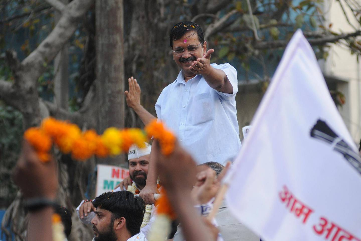 epa07540482 Aam Aadmi Party chief and Delhi Chief minister Arvind Kejriwal (C), gestures during an election campaign road show in New Delhi, India, 01 May 2019. Voting for the Parliamentary elections in Delhi will be held in a single phase on 12 May 2019. The parliamentary elections, which began on 11 April 2019, are to be conducted in seven phases throughout India and result will be announced on 23 May.  EPA/STR