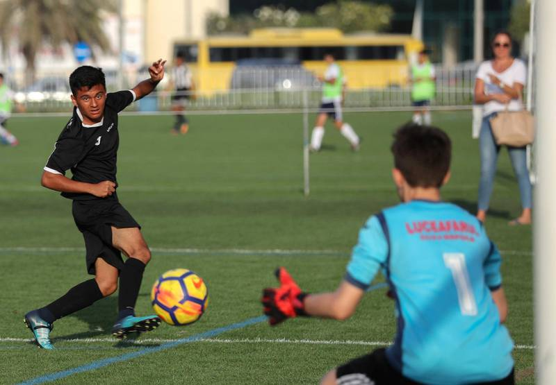 Abu Dhabi, March 24, 2018.  Manchester City Abu Dhabi Cup for juniors. George Espinosa of Muscat Football Academy attemts a goal during the under 14 finals match against CS Luceafarul from Romania.Victor Besa / The NationalSportsReporter:  Amith Passela