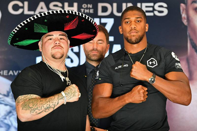 """Mexican-US WBA, IBF, WBO and IBO heavyweight boxing champion Andy Ruiz Jr (L) and Britain's Anthony Joshua (R) pose next to each other at a promotional press conference for the """"Clash on the Dunes"""" fight, set to take place in December, in London on September 6, 2019. The """"Clash on the Dunes"""" is scheduled to take place in Diriya, Saudi Arabia on December 7.   / AFP / DANIEL LEAL-OLIVAS"""