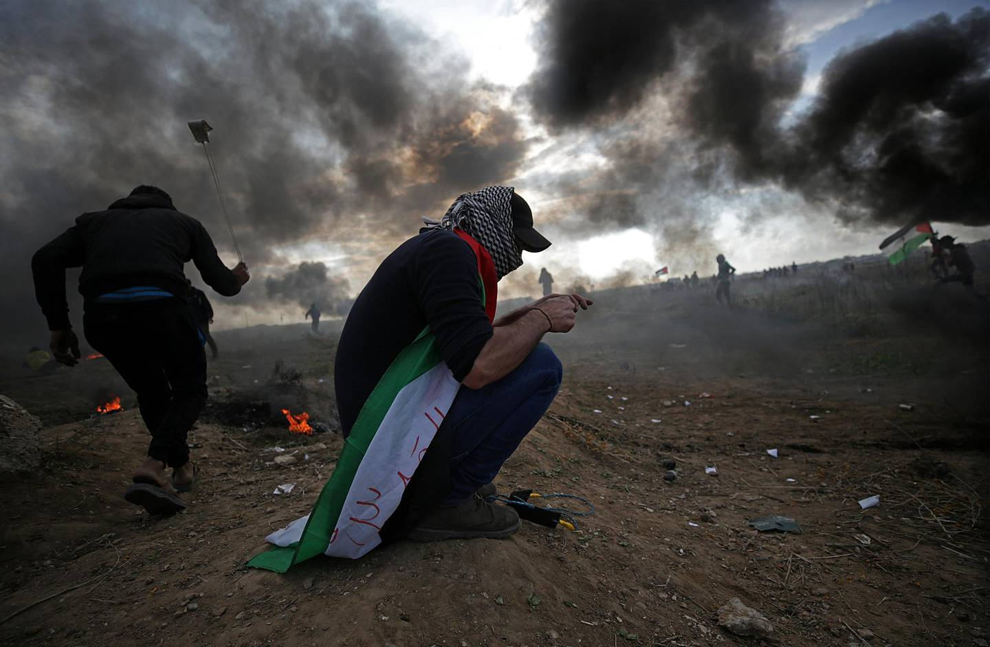 epa06392274 Palestinian protesters throw stones at Israeli troops during clashes near the border with Israel, against US President decision to recognize Jerusalem as the capital of Israel, in the east of Gaza City, 15 December 2017. Two Palestinians were killed during the clashes in the east of Gaza Strip. US president Donald J. Trump on 06 December announced he is recognizing Jerusalem as the Israel capital and will relocate the US embassy from Tel Aviv to Jerusalem.  EPA/MOHAMMED SABER