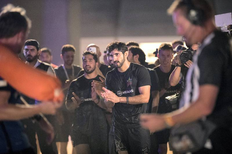 DUBAI, UNITED ARAB EMIRATES - MAY 12, 2018. Crown Prince of Dubai,  Sheikh Hamdan bin Mohammed cheers the arriving terams at the finish line at Govgames.His team, F3, won first place.Set in motion by the Crown Prince of Dubai,  Sheikh Hamdan bin Mohammed, Govgames sees teams of Government workers pitted against each other in a bid to be Gov Games champions.The competition is held on Kite Beach.(Photo by Reem Mohammed/The National)Reporter: Section: NA