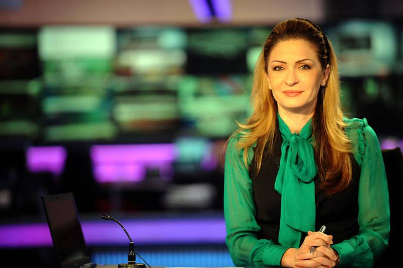 (FILES) A file photo taken on December 15, 2009 shows Lebanese Al-Arabiya TV anchorwoman, Najwa Qassem, at the studios of the Arab news channel's headquarters in Dubai. Al-Arabiya announced the death of Qassem, 52, at her residence in the Gulf emirate of Dubai on January 2, 2020, without giving any further details.   / AFP / BALKIS PRESS / AMMAR ABD RABBO