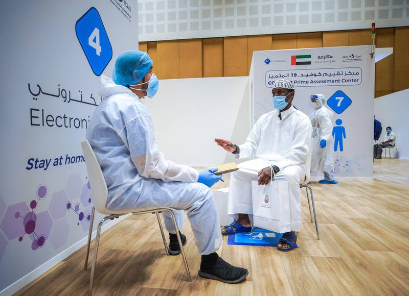 Abu Dhabi, United Arab Emirates, June 4, 2020.     A patient is interviewed by a healthcare worker at he new Covid-19 Prime Assessment Center at ADNEC.Victor Besa  / The NationalSection:  NAReporter:  Shireena Al Nowais