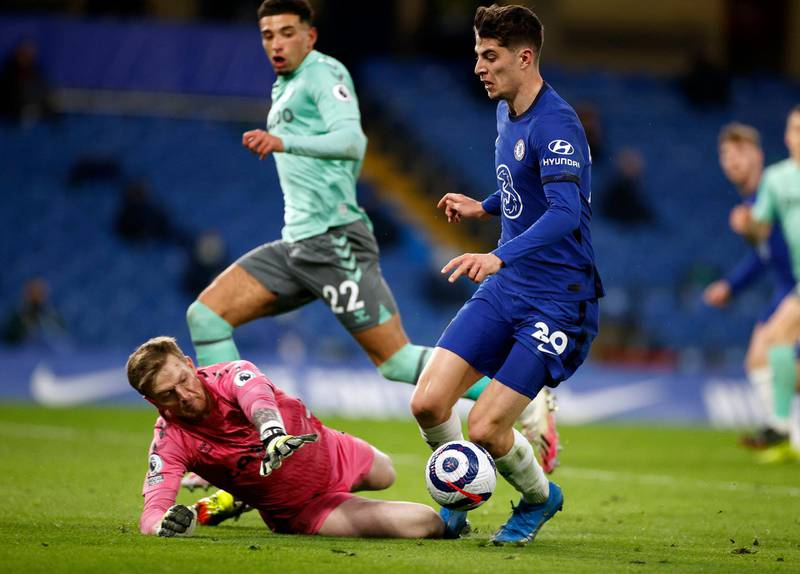 """Everton goalkeeper Jordan Pickford fouls Chelsea's Kai Havertz resulting in a penalty during the Premier League match at Stamford Bridge, London. Picture date: Monday March 8, 2021. PA Photo. See PA story SOCCER Chelsea. Photo credit should read: John Sibley/PA Wire.RESTRICTIONS: EDITORIAL USE ONLY No use with unauthorised audio, video, data, fixture lists, club/league logos or """"live"""" services. Online in-match use limited to 120 images, no video emulation. No use in betting, games or single club/league/player publications."""