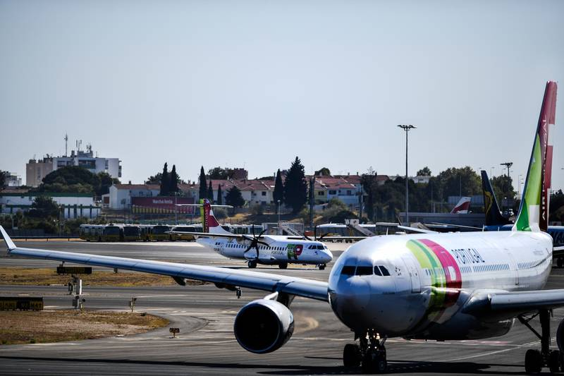 Planes of Portuguese airline TAP are pictured at Humberto Delgado airport in Lisbon on October 3, 2018. (Photo by PATRICIA DE MELO MOREIRA / AFP)