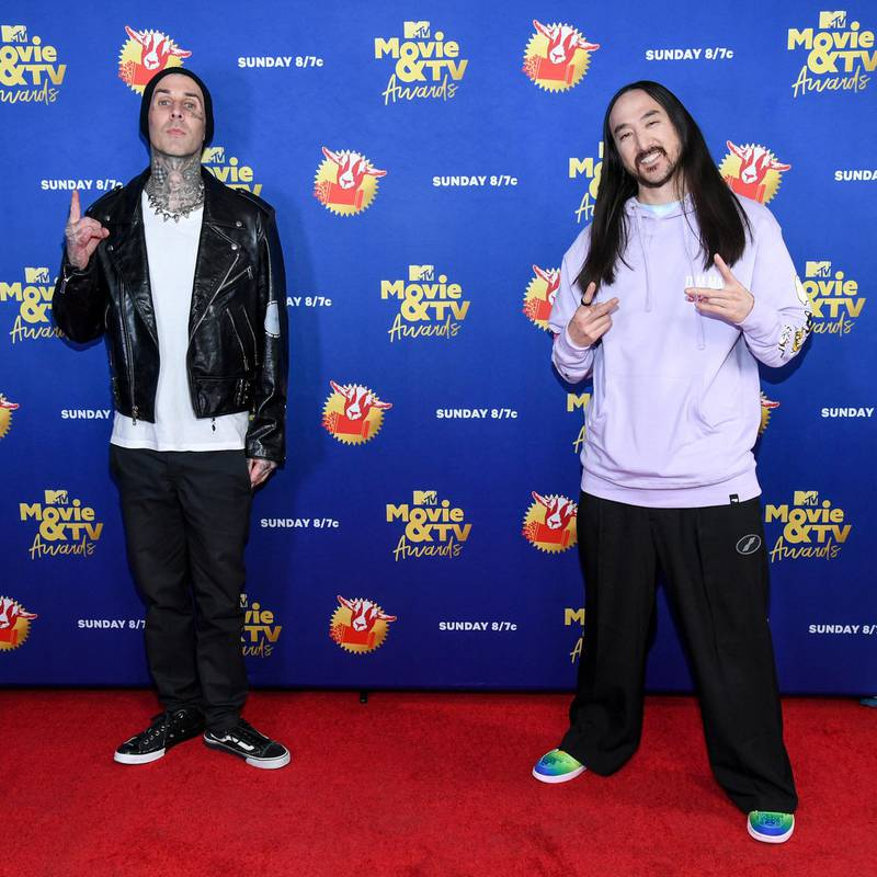 UNSPECIFIED - DECEMBER 06: In this image released on December 6, Travis Barker and Steve Aoki attends the 2020 MTV Movie & TV Awards: Greatest Of All Time broadcast on December 6, 2020. (Photo by Kevin Mazur/2020 MTV Movie & TV Awards/Getty Images)