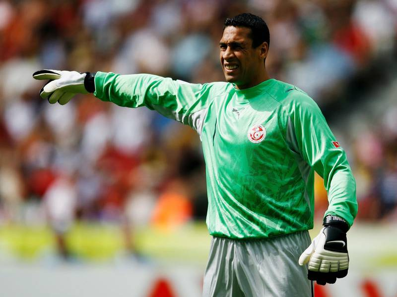 BERLIN - JUNE 23: Ali Boumnijel of Tunisia gestures during the FIFA World Cup Germany 2006 Group H match between Ukraine and Tunisia played at the Olympic Stadium on June 23, 2006 in Berlin, Germany. (Photo by Shaun Botterill/Getty Images)