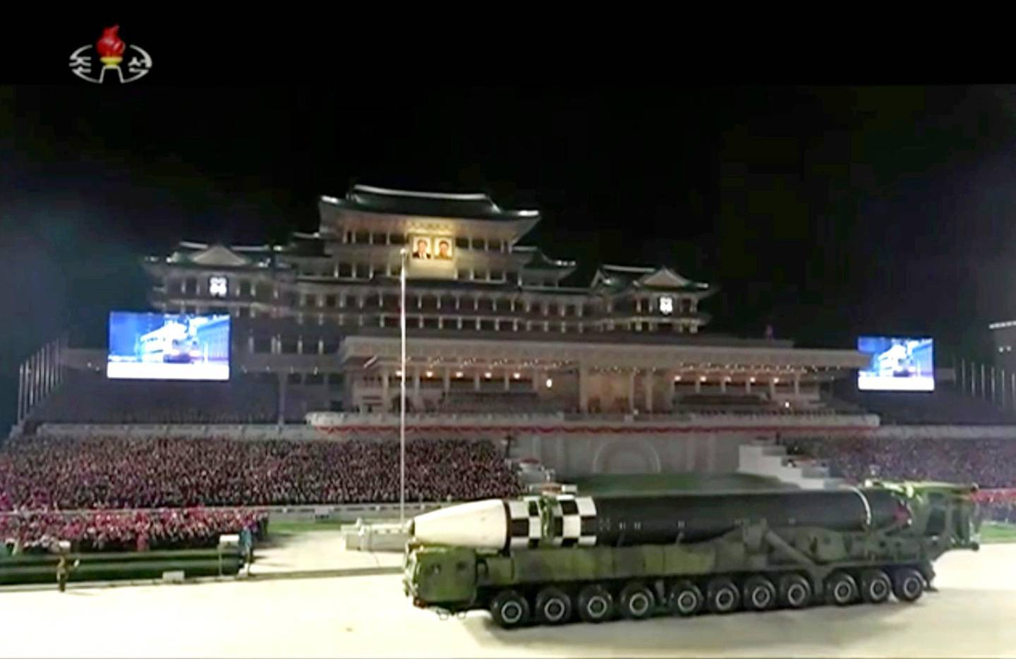 """This image made from video broadcasted by North Korea's KRT, shows a military parade with what appears to be a possible new intercontinental ballistic missile at the Kim Il Sung Square in Pyongyang, Saturday, Oct. 10, 2020. North Korean leader Kim Jong Un warned Saturday that his country would """"fully mobilize"""" its nuclear force if threatened as he took center stage at a massive military parade to mark the 75th anniversary of the country's ruling party. (KRT via AP)"""