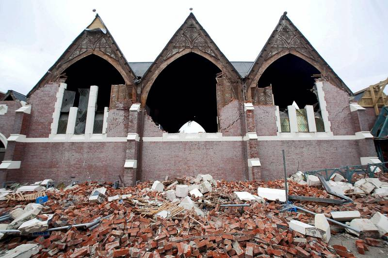 The badly damaged Knox Presbyterian Church surrounded by rubble on February 23, 2011, a day after Christchurch was rocked by a 6.3 magnitude earthquake. AFP