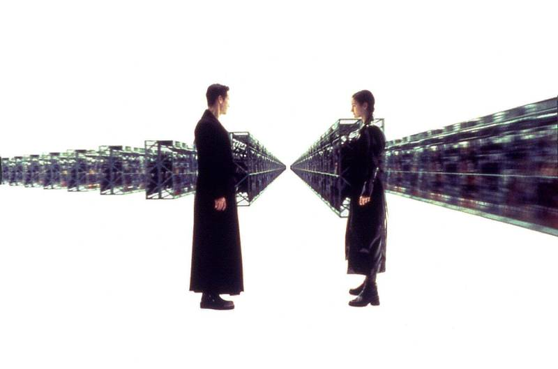 Keanu Reeves and Carrie Ann-Moss in The Matrix. Courtesy Warner Bros.