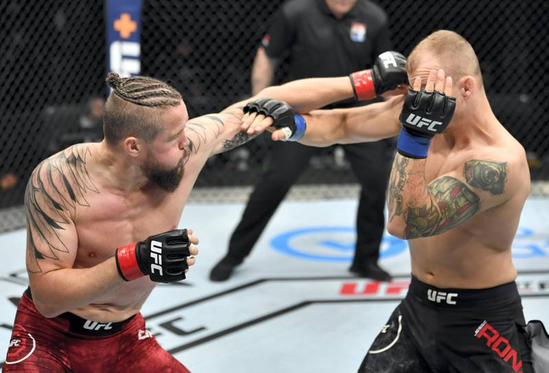 ABU DHABI, UNITED ARAB EMIRATES - JULY 26: (L-R) Nicolas Dalby of Denmark punches Jesse Ronson of Canada in their welterweight fight during the UFC Fight Night event inside Flash Forum on UFC Fight Island on July 26, 2020 in Yas Island, Abu Dhabi, United Arab Emirates. (Photo by Jeff Bottari/Zuffa LLC via Getty Images) *** Local Caption *** ABU DHABI, UNITED ARAB EMIRATES - JULY 26: (L-R) Nicolas Dalby of Denmark punches Jesse Ronson of Canada in their welterweight fight during the UFC Fight Night event inside Flash Forum on UFC Fight Island on July 26, 2020 in Yas Island, Abu Dhabi, United Arab Emirates. (Photo by Jeff Bottari/Zuffa LLC via Getty Images)