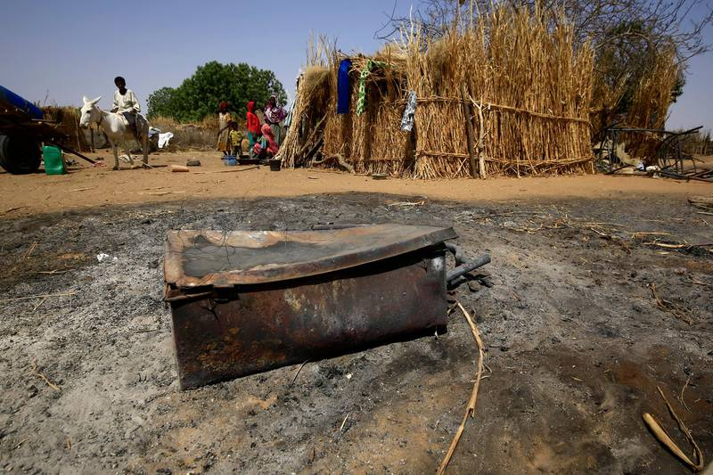A picture shows the aftermath of violence in the Sudanese village of al-Twail Saadoun, 85 kilometres south of Nyala town, the capital of South Darfur, on February 2, 2021. - The combined death toll from recent violence in Sudan's restive Darfur region has risen above 200, after medics revised the toll from one set of clashes upwards by over 50. (Photo by ASHRAF SHAZLY / AFP)