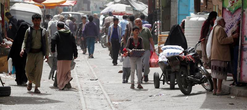 epa08252783 Yemenis walk through a street in Sana'a, Yemen, 27 February 2020. According to reports, aid groups and donors are planning to suspend humanitarian assistance to the Houthi-controlled northern areas of Yemen in the coming months, accusing the Houthis of diverting food assistance from the hungriest Yemenis. Over 24 million people are in desperate need of humanitarian aid due to a five-year armed conflict between the Saudi-backed Yemeni government and the Houthis.  EPA/YAHYA ARHAB