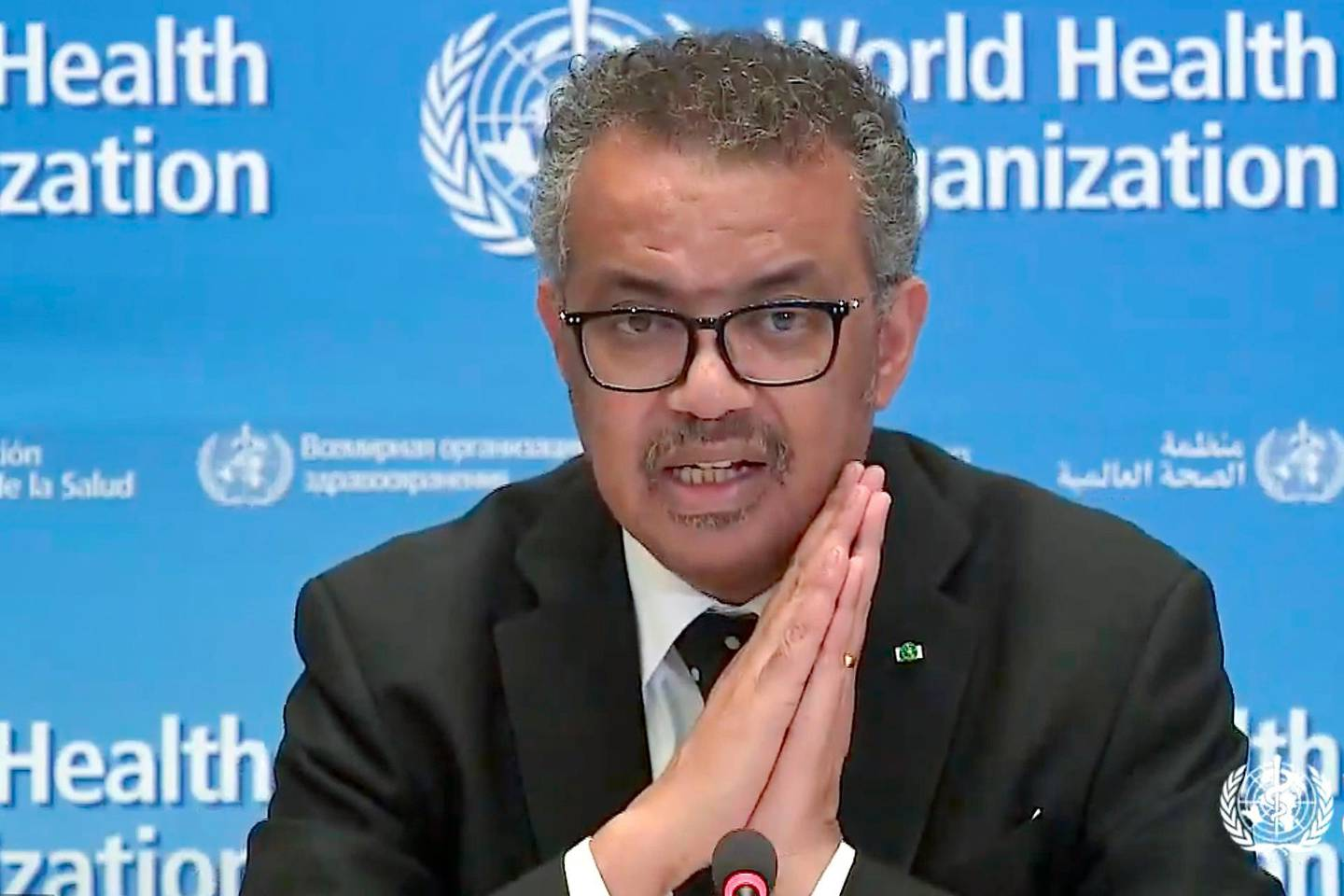 """A tv grab taken from the World Health Organization website shows WHO Chief Tedros Adhanom Ghebreyesus delivering a virtual news briefing on COVID-19 (novel coronavirus) at the WHO headquarters in Geneva on March 23, 2020. The new coronavirus pandemic is clearly """"accelerating"""", WHO chief warned on March 23, 2020, but stressed it was still possible to """"change the trajectory"""" of the outbreak. / AFP / -"""