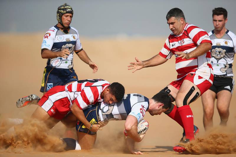 RAS AL KHAIMAH, UNITED ARAB EMIRATES - OCTOBER 21:  Alan Monkhouse of Beaver Nomads is tackled by Tristan Noel of RAK Goats  during the Community League match between RAK Goats and Beaver Nomads at Bin Majid Beach Resort on October 21, 2016 in Ras Al Khaimah, United Arab Emirates.  (Photo by Francois Nel/Getty Images)