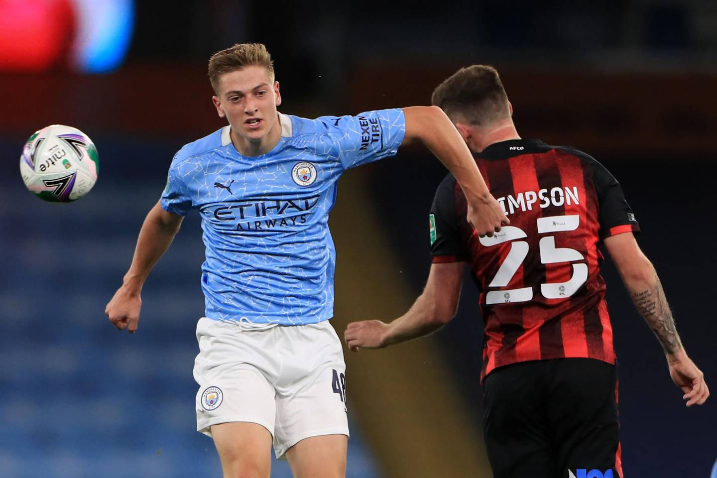 Manchester City's English midfielder Liam Delap (L) vies with Bournemouth's English defender Jack Simpson (R) during the English League Cup third round football match between Manchester City and Bournemouth at the Etihad Stadium in Manchester, north-west of England, on September 24, 2020.   - RESTRICTED TO EDITORIAL USE. No use with unauthorized audio, video, data, fixture lists, club/league logos or 'live' services. Online in-match use limited to 120 images. An additional 40 images may be used in extra time. No video emulation. Social media in-match use limited to 120 images. An additional 40 images may be used in extra time. No use in betting publications, games or single club/league/player publications.  / AFP / POOL / MIKE EGERTON / RESTRICTED TO EDITORIAL USE. No use with unauthorized audio, video, data, fixture lists, club/league logos or 'live' services. Online in-match use limited to 120 images. An additional 40 images may be used in extra time. No video emulation. Social media in-match use limited to 120 images. An additional 40 images may be used in extra time. No use in betting publications, games or single club/league/player publications.