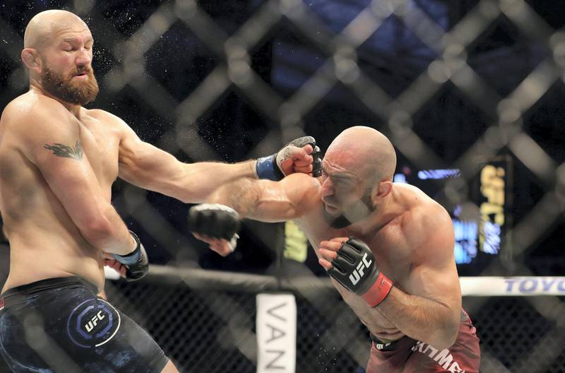 Abu Dhabi, United Arab Emirates - September 07, 2019: Middleweight bout between Omari Akhmedov (red shorts, Winner) and Zak Cummings in the Early Prelims at UFC 242. Saturday the 7th of September 2019. Yas Island, Abu Dhabi. Chris Whiteoak / The National