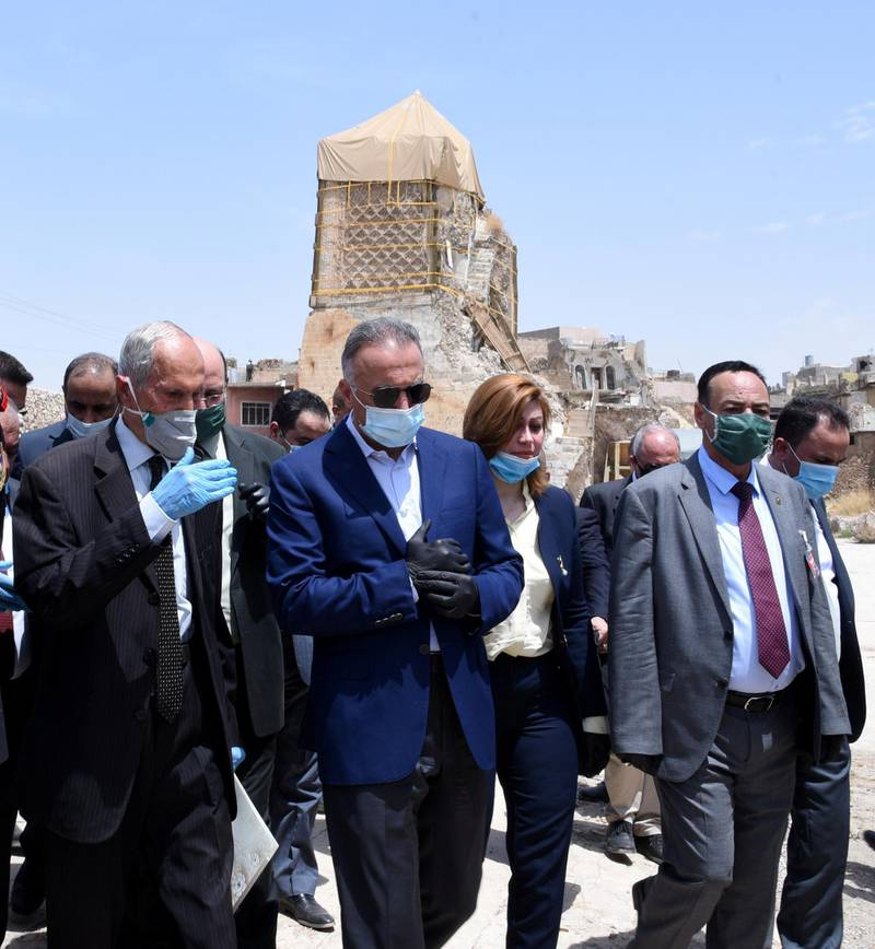 epa08477057 Iraqi Prime Minister Mustafa al-Kadhimi (C) visits the Great Mosque of al-Nuri in the Old City area, on the west side of Mosul city, northern Iraq, 10 June 2020. Al-Kadhimi visited Mosul on the sixth anniversary of its occupation by militants of the Islamic State (IS) terror organization in June 2014, after which Iraqi troops backed by the US-led international coalition forces launched a military campaign that lasted for three years to expel the IS  fighters from the city.  EPA-EFE/AMMAR SALIH *** Local Caption *** 56143248