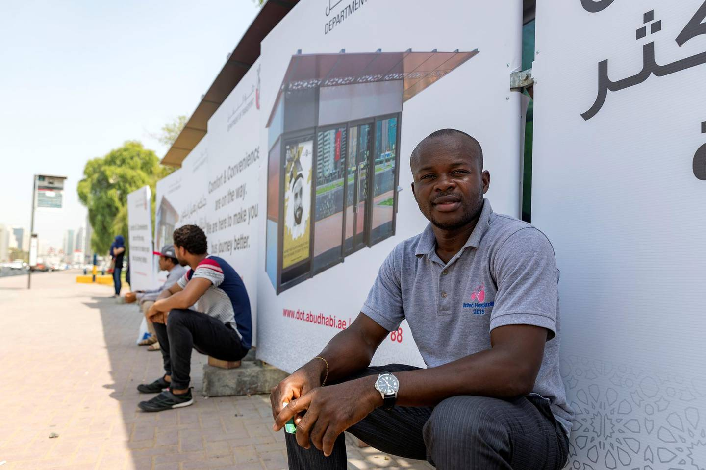 Abu Dhabi, United Arab Emirates - August 14, 2018: Bus user Brain Ekole. A new bus shelter being built in Abu Dhabi. A story on the reaction from users of the bus service to the new shelters. Tuesday, August 14th, 2018 on Sultan bin Zayed the 1st Street, Abu Dhabi. Chris Whiteoak / The National