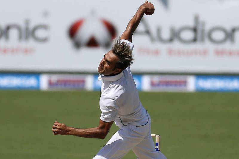 DUBAI , UNITED ARAB EMIRATES : Oct 23 , 2013 :- Imran Tahir of South Africa bowling to Misbah - ul - Haq during the first day of the test match between Pakistan vs South Africa at Dubai International Cricket Stadium in Dubai. He took five wickets in the first inning. ( Pawan Singh / The National ) . For Sports. Story by Paul Radley