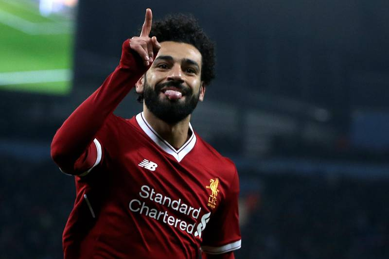epa06660220 Liverpool's Mohamed Salah celebrates after scoring the 1-1 equalizer during the UEFA Champions League quarter final second leg match between Manchester City and FC Liverpool in Manchester, Britain, 10 April 2018.  EPA/Nigel Roddis