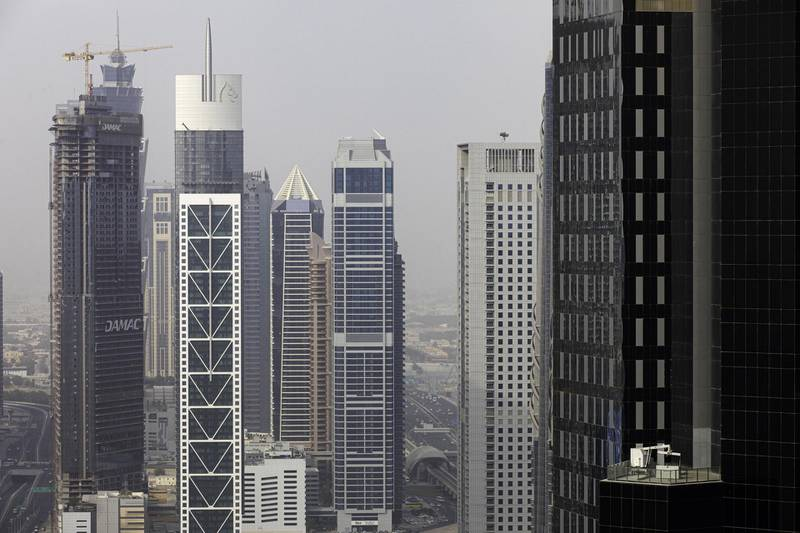 Skyscrapers stand on the city skyline in Dubai, United Arab Emirates, on Tuesday, July 23, 2019. Like the rest of the city, the business center has suffered from a prolonged real-estate slump brought on by oversupply and slower economic growth. Photographer: Christopher Pike/Bloomberg