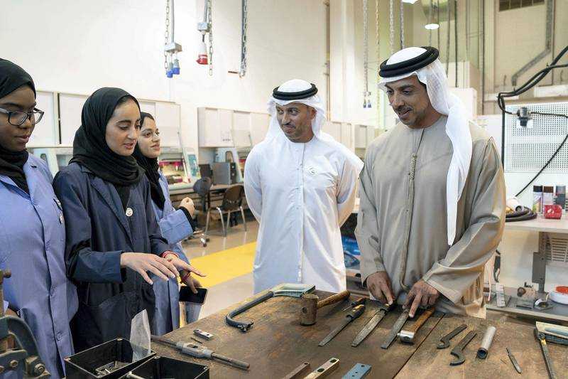 AL AIN, ABU DHABI, UNITED ARAB EMIRATES - February 7, 2019: HH Sheikh Mansour bin Zayed Al Nahyan, UAE Deputy Prime Minister and Minister of Presidential Affairs (R), and HE Dr Ahmed Abdullah Humaid Belhoul Al Falasi, UAE Minister of State for Higher Education (2nd R), speak with students while visiting UAE University in Al Ain.  ( Ryan Carter / Ministry of Presidential Affairs ) ---