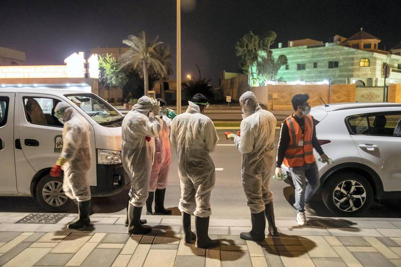 SHARJAH, UNITED ARAB EMIRATES. 26 MARCH 2020. Sharjah Municipal staff prepare to spray and disinfect the sidewalk along the Al Muntazah Str area of Sharjah near the Ajman border. (Photo: Antonie Robertson/The National) Journalist: None. Section: National.