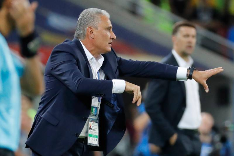 epa06845514 Brazil's coach Tite reacts during the FIFA World Cup 2018 group E preliminary round soccer match between Serbia and Brazil in Moscow, Russia, 27 June 2018.  (RESTRICTIONS APPLY: Editorial Use Only, not used in association with any commercial entity - Images must not be used in any form of alert service or push service of any kind including via mobile alert services, downloads to mobile devices or MMS messaging - Images must appear as still images and must not emulate match action video footage - No alteration is made to, and no text or image is superimposed over, any published image which: (a) intentionally obscures or removes a sponsor identification image; or (b) adds or overlays the commercial identification of any third party which is not officially associated with the FIFA World Cup)  EPA/FELIPE TRUEBA   EDITORIAL USE ONLY