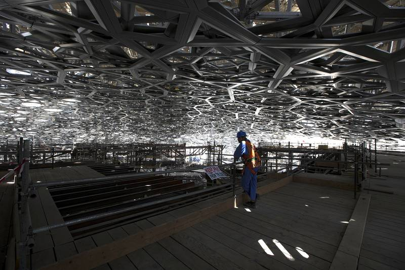 ABU DHABI, UNITED ARAB EMIRATES, May 28, 2015:   View of the inside of the Louvre Abu Dhabi's dome, which grows more intricate with each day, as its cladding is applied in layers, while the temporary scaffolding and steel structures beneath it are now being removed, as seen on Thursday, May 28, 2015, at the gallery's location on Saadiyat Island in Abu Dhabi.   (Silvia Razgova / The National)  (Usage: undated, RESTRICTED, Section: NA, Reporter: Nick Leech) *** Local Caption ***  SR-150528-LAD0266.jpg