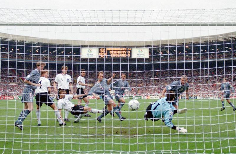 LONDON, ENGLAND - JUNE 26: England striker Alan Shearer ( right) heads in the England goal past goalkeeper Andreas Kopke as team mates Steve McManaman (l) David Platt (6th left) and Teddy Sheringham (c) look on during the 1996 UEFA European Championships semi final at Wembley Stadium on June 26, 1996 in London, United Kingdom. (Photo by Ross Kinnaird/Allsport/Getty Images/Hulton Archive)