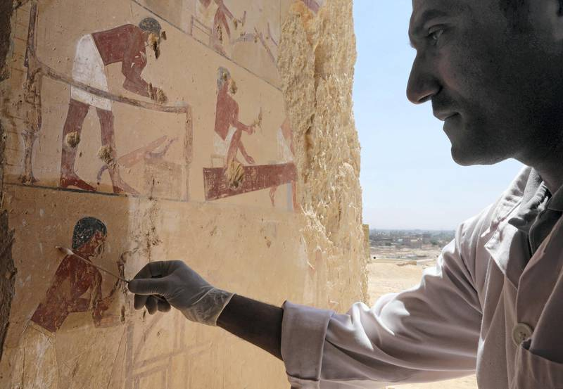 """An Egyptian archaeologist works inside one of the largest newly discovered pharaonic tombs """"Shedsu Djehuty"""" in Luxor, Egypt April 18, 2019. REUTERS/Mohamed Abd El Ghany"""