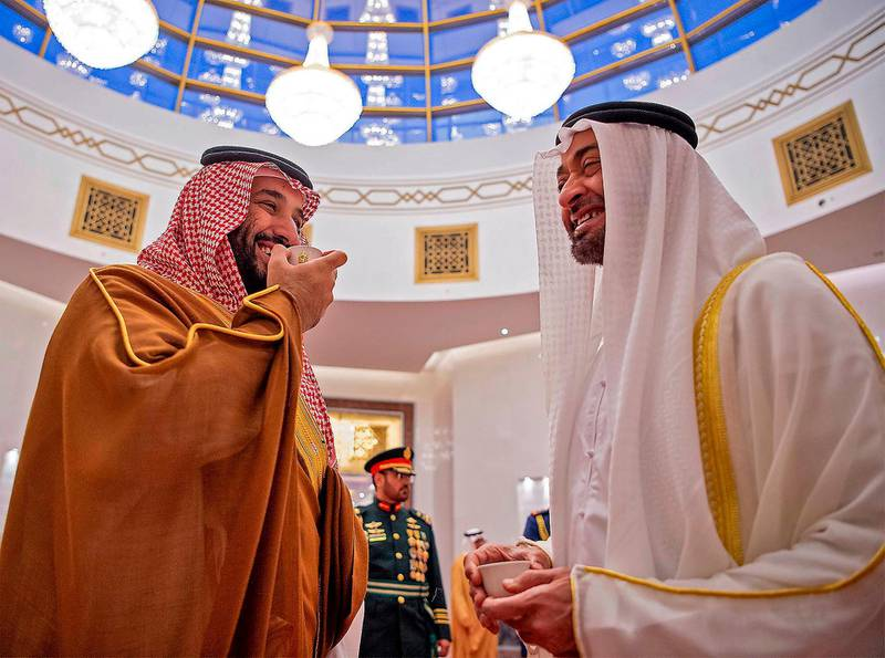 """A handout picture provided by the Saudi Royal Palace on November 27, 2019, shows Abu Dhabi Crown Prince Sheikh Mohammed bin Zayed Al-Nahyan (R) and Saudi Crown Prince Mohammed bin Salman drinking coffe in Abu Dhabi.  Mohammed bin Salman visited the United Arab Emirates, as efforts to end the nearly five-year war in Yemen gain momentum. Riyadh and Abu Dhabi are close allies and key members of a military coalition backing the government in Yemen against the Iran-aligned Huthi rebels. - RESTRICTED TO EDITORIAL USE - MANDATORY CREDIT """"AFP PHOTO / SAUDI ROYAL PALACE / BANDAR AL-JALOUD"""" - NO MARKETING - NO ADVERTISING CAMPAIGNS - DISTRIBUTED AS A SERVICE TO CLIENTS  / AFP / Saudi Royal Palace / Bandar AL-JALOUD / RESTRICTED TO EDITORIAL USE - MANDATORY CREDIT """"AFP PHOTO / SAUDI ROYAL PALACE / BANDAR AL-JALOUD"""" - NO MARKETING - NO ADVERTISING CAMPAIGNS - DISTRIBUTED AS A SERVICE TO CLIENTS"""
