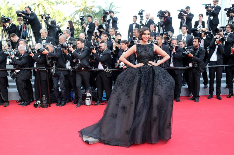 """Indian actress Sonam Kapoor poses as she arrives for the screening of the film """"The Homesman"""" at the 67th edition of the Cannes Film Festival in Cannes, southern France, on May 18, 2014.     AFP PHOTO / LOIC VENANCE (Photo by LOIC VENANCE / AFP)"""