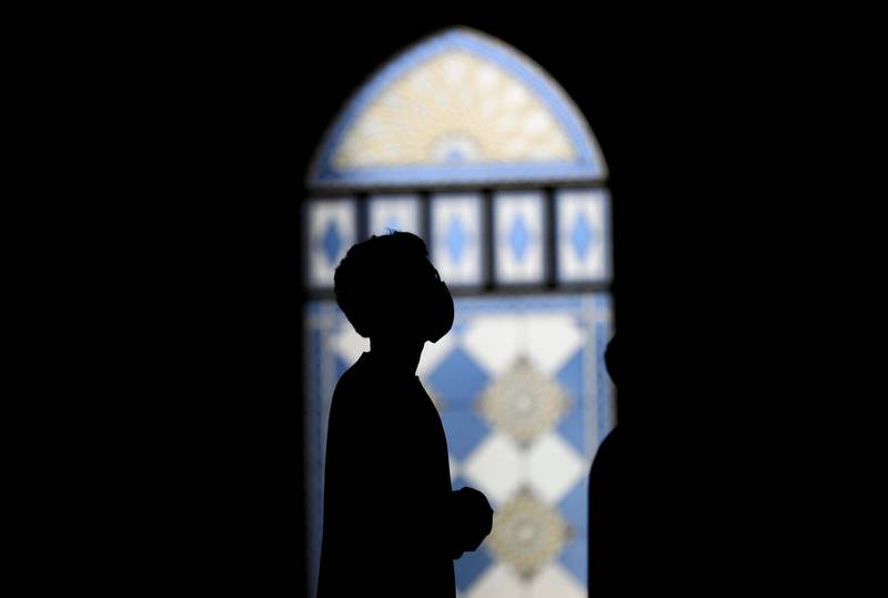 DUBAI, UNITED ARAB EMIRATES - JULY 01: A Muslim man prays at Al Farooq Omar Bin Al Khattab Mosque on July 01, 2020 in Dubai, United Arab Emirates. The UAE's first socially-distanced prayers took place today as mosques across the country reopened at 30 per cent capacity. (Photo by Francois Nel/Getty Images)