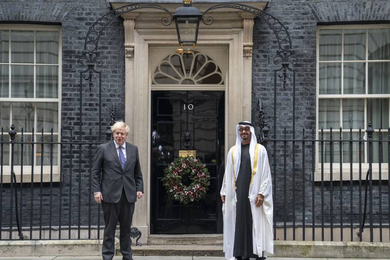 LONDON, UNITED KINGDOM - December 10, 2020: HH Sheikh Mohamed bin Zayed Al Nahyan, Crown Prince of Abu Dhabi and Deputy Supreme Commander of the UAE Armed Forces (R), stands for a photograph with The Rt Hon Boris Johnson, Prime Minister of the United Kingdom (L), prior to a meeting at No 10 Downing Street.  ( Hamad Al Kaabi / Ministry of Presidential Affairs ) ---