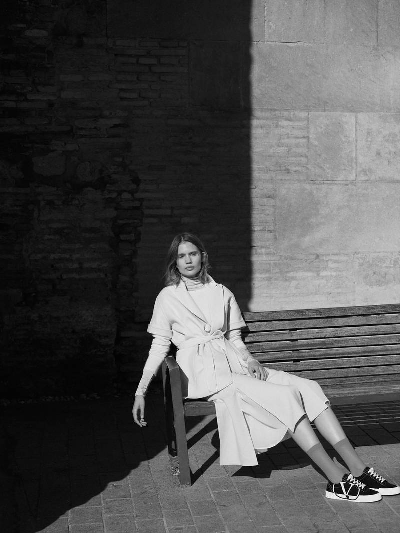 OUT OF SHADOWS.Photography   Ezra Patchett   fashion director   Sarah MaiseyJumper, Dh1,995; coat, Dh5,800; and skirt, Dh2,290, all from Max Mara. Trainers, Dh2,360, Valentino. Socks, stylist's own