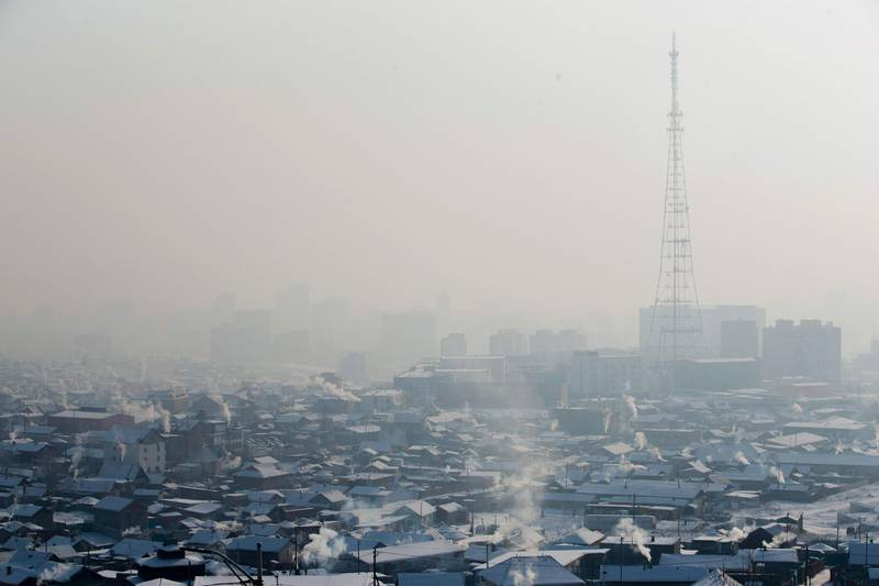 """CORRECTION - This picture taken on January 21, 2018 shows smoke rising from chimneys of houses amid smog on a polluted day in Ulaanbaatar, the capital of Mongolia. Fed up with the smog in Mongolia's capital, residents have resorted to sipping """"lung"""" tea and """"oxygen cocktails"""" in a desperate bid to protect themselves from pollution, despite health officials saying there is no evidence they work.  / AFP PHOTO / BYAMBASUREN BYAMBA-OCHIR / TO GO WITH AFP STORY MONGOLIA-POLLUTION,FEATURE BY ANAND TUMURTOGOO / """"The erroneous mention[s] appearing in the metadata of this photo by BYAMBASUREN BYAMBA-OCHIR has been modified in AFP systems in the following manner: [adding year 2018]. Please immediately remove the erroneous mention[s] from all your online services and delete it (them) from your servers. If you have been authorized by AFP to distribute it (them) to third parties, please ensure that the same actions are carried out by them. Failure to promptly comply with these instructions will entail liability on your part for any continued or post notification usage. Therefore we thank you very much for all your attention and prompt action. We are sorry for the inconvenience this notification may cause and remain at your disposal for any further information you may require."""""""