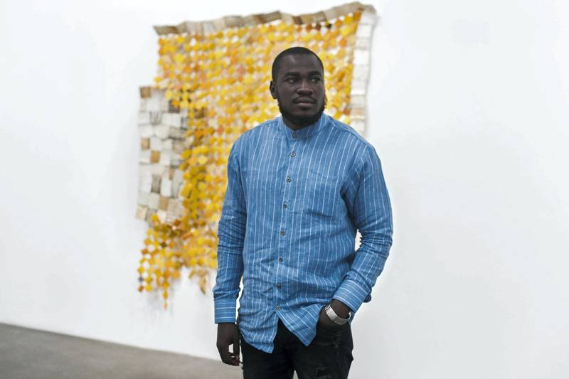 """DUBAI, UNITED ARAB EMIRATES - Jan 24, 2018. Ghanaian artist Serge Attukwei Clottey, at Lawrie Shabibi in Alserkal Avenue, where his work """"Displaced"""" is showing.(Photo by Reem Mohammed/The National)Reporter: Section: NA"""