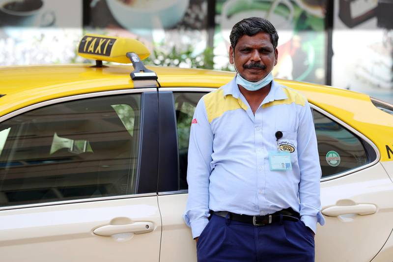 """Dubai, United Arab Emirates - Reporter: N/A: UAE Heroes. Navas Ellias aged 51 from India is a taxi driver. He said """"The company provided us with face masks which we use and after our shift we go straight home. The public have been ugly positive to us staying out"""". Tuesday, March 24th, 2020. Dubai. Chris Whiteoak / The National"""