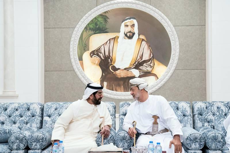 ABU DHABI, UNITED ARAB EMIRATES - January 30, 2018: HH Sayyid Haitham bin Tariq al Said, Minister of Heritage & Culture of Oman (R), offers condolences to HH Sheikh Tahnoon bin Mohamed Al Nahyan, Ruler's Representative in Al Ain Region (L), on the passing of HH Sheikha Hessa bint Mohamed Al Nahyan, at Mushrif Palace. ( Hamad Al Kaabi / Crown Prince Court - Abu Dhabi ) —